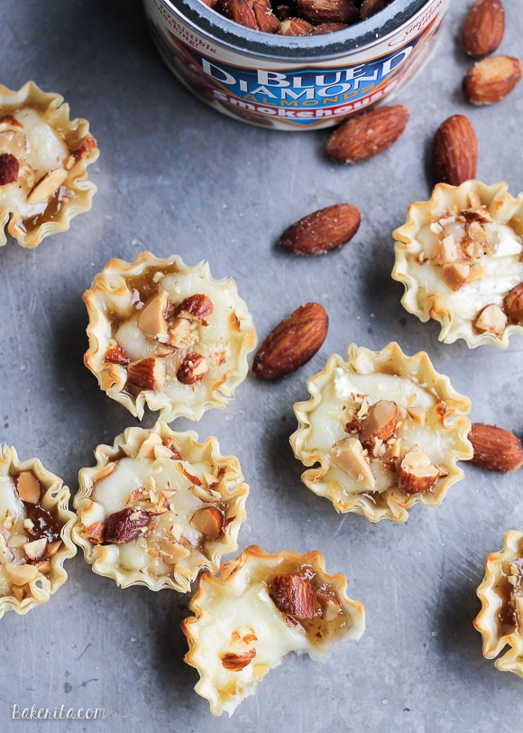 These Easy Brie Bites have only four ingredients, but make a delicious appetizer that you won't be able to get enough of! Gooey brie and crunchy smokehouse almonds make this simple appetizer recipe shine.