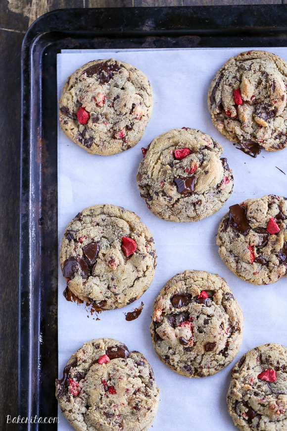 These Chocolate-Dipped Strawberry Chocolate Chip Cookies are soft + chewy cookies full of freeze dried strawberries and chocolate chunks, dipped and drizzled with dark chocolate.