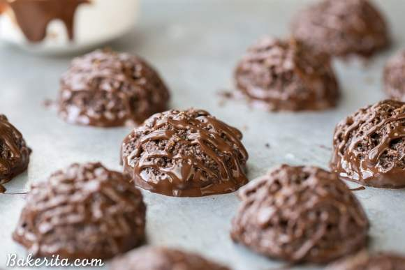 These rich Double Chocolate Macaroons are made super chocolatey with both cocoa powder and melted chocolate. These easy cookies are dipped and drizzled with chocolate, and they're gluten-free, Paleo + vegan.