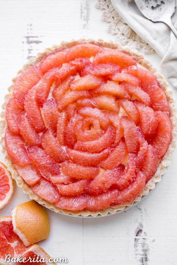 This Grapefruit Tart has a bright, tart grapefruit flavor from the silky grapefruit curd, and it's topped with gorgeous pink grapefruit segments! This gluten-free, Paleo, and refined sugar free tart is a stunning way to show off grapefruit.