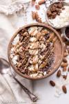 This Almond Chocolate Coconut Smoothie Bowl is refreshing and chocolatey - it's an absolutely delicious way to start the day! This easy recipe is gluten-free, vegan, and comes together in 5 minutes.