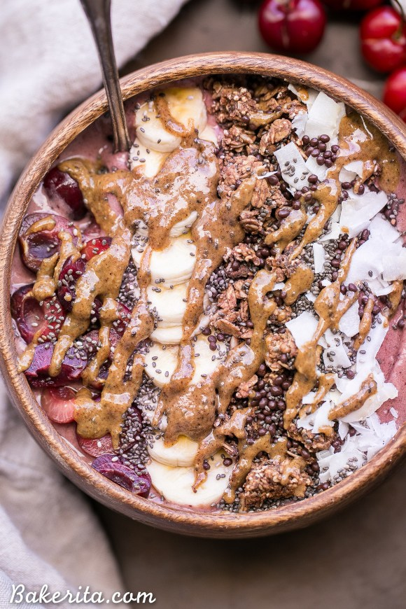 This Banana Cherry Smoothie Bowl is a healthy and delicious breakfast treat! It's refreshing, filling, and loaded with beautifying superfoods. Add all your favorite toppings for a treat suited just to your tastes.