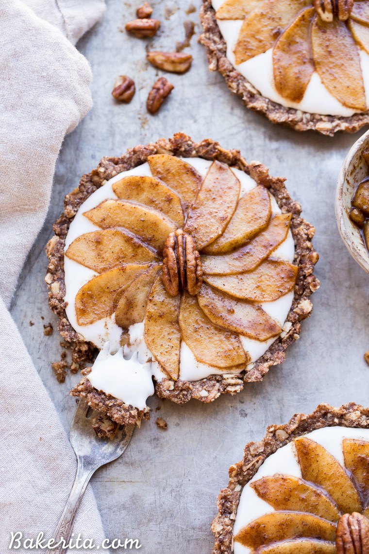 These Granola Breakfast Tarts with Sauteed Apples + Coconut Yogurt are an incredible breakfast treat that's so good, you'll think it's dessert! The granola crust is spread with creamy dairy-free coconut yogurt and topped with cinnamon sauteed apples. This gluten-free, paleo and vegan breakfast is the perfect holiday morning breakfast, or to make any morning more special.