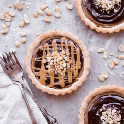 Chocolate Peanut Butter Caramel Tarts with Shortbread Crust (Gluten Free, Grain Free + Vegan)