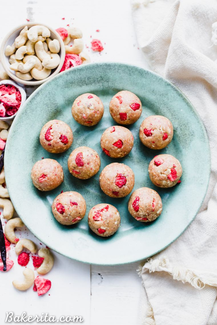These Strawberry VanillaBean Energy Balls are an easy, no-bake snack that tastes like strawberry shortcake! With a base of raw cashews, they're buttery and deliciously flavored with vanilla and strawberries. They're gluten-free, paleo, and vegan, and perfect for bringing on the go.