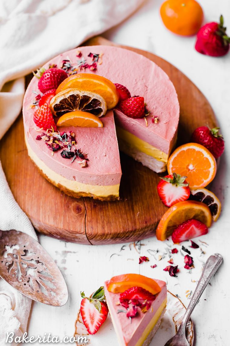 This Strawberry Orange Cheesecake with Coconut Crust is not just beautiful, but it's bright in flavor and absolutely delicious! The lemony coconut macaroon crust is perfect with the strawberry and orange flavors. You're going to adore this gluten-free, paleo and vegan cheesecake.
