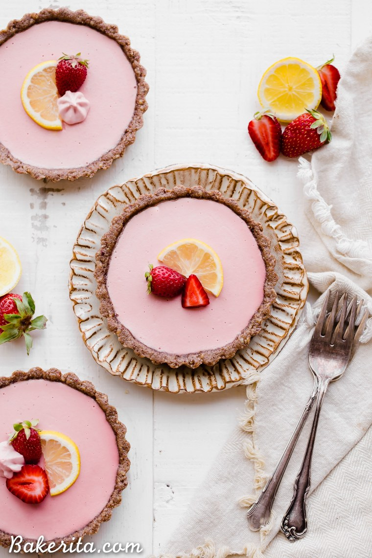 "These No Bake Strawberry Lemonade Tarts have a raw ""graham cracker"" style crust filled with a super refreshing strawberry lemonade filling. These are SO good frozen on a hot day and they're gluten-free, paleo and vegan."
