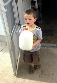 Frank loading his milk in the truck.