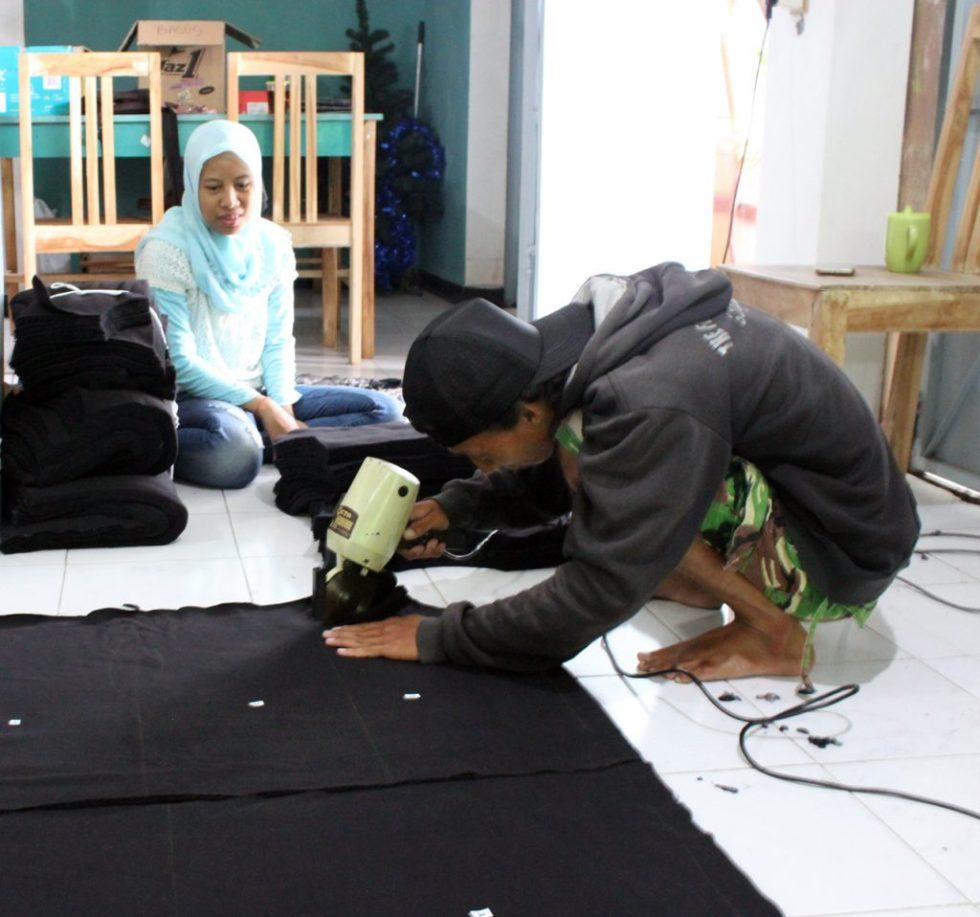 Cutting Fabric by Baki Clothing Company