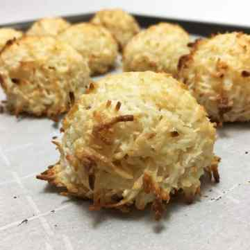 A batch of Coconut Macaroons on the parchment