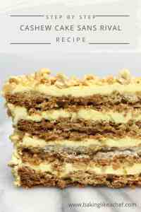 A slice of Cake Sans Rival with layers of meringue and buttercream on a marble board
