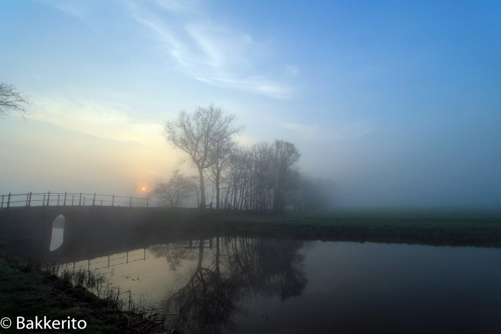 Misty sunrise in Dutch landscape