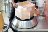 man using wrapping machine