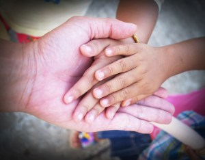 child's hands in adult hand