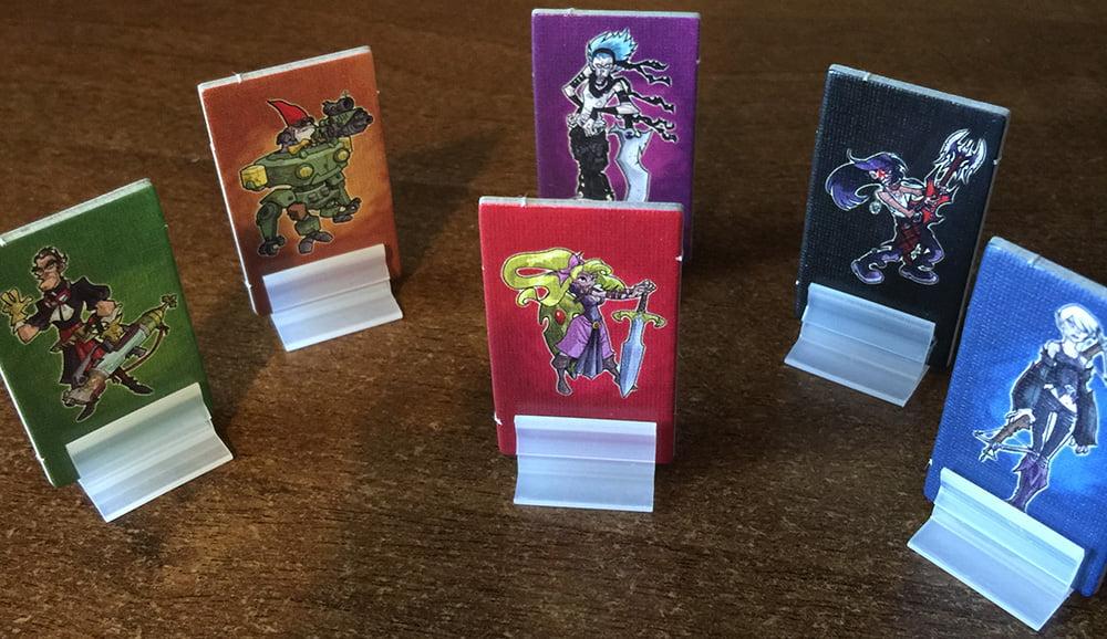 Le pedine dei 6 personaggi giocabili
