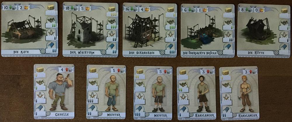 All'inizio della partita, troviamo al centro del tavolo 5 Edifici da costruire e 5 Operai da assoldare.