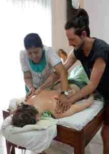 Bali BISA trainer demonstrating a massage technique