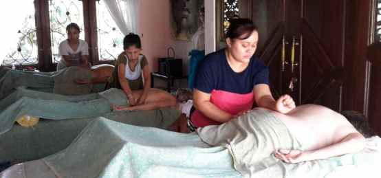 Students practice massage with outside model to gain their practical skills