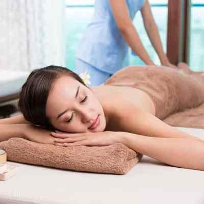 Woman having full body massage treatment. Learn how with ITEC Body Massage certificate