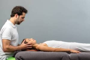Male Spa Therapist - working on the head