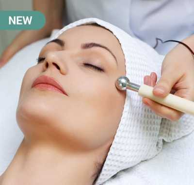 young woman receiving new electrical facial treatment