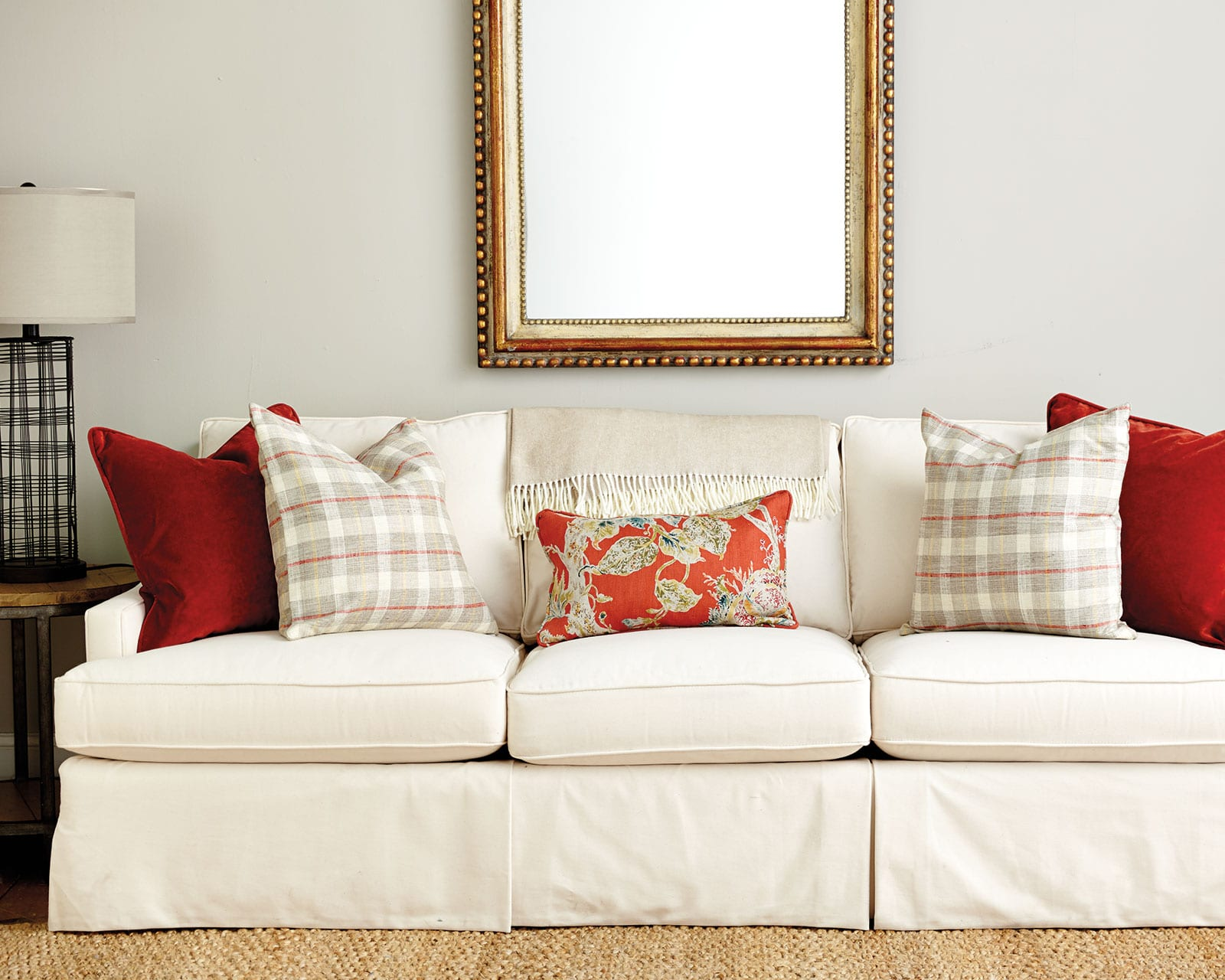 Guide to Choosing Throw Pillows   How To Decorate Spicy orange throw pillows on a sofa