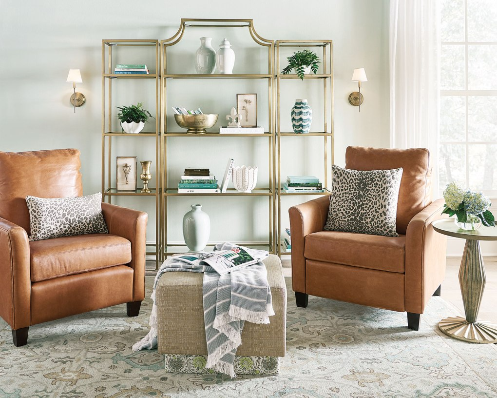 Two light colored leather furniture chairs in a living room