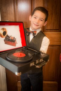 "Here's my little Thomas Edison heading off to school with his portable Crosley ""phonograph"" for his presentation prop."