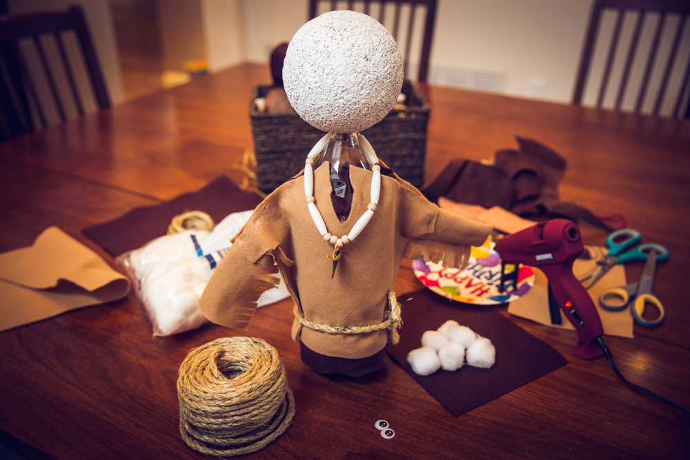 """My dining room table was taken over by this project - scraps of leather and felt, beads, rope, hot glue guns, scissors, and many other treasures I found in my """"art closet""""!"""