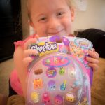 This is one happy girl! A new pack of Shopkins!!