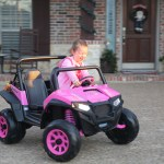 She couldn't wait to get her pink Peg Perego outside! She threw on a jacket over her PJs and drove it around the driveway!