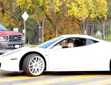 Justin Bieber in his white Ferrari.
