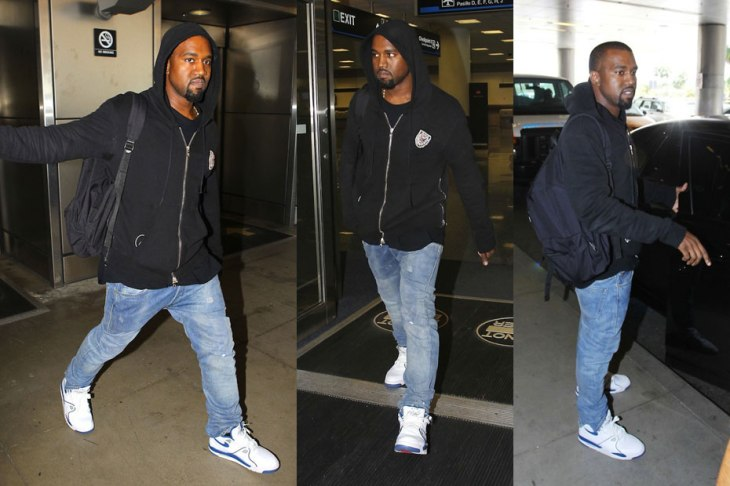 Kanye West rocks a pair of custom Levi's 514 jeans.