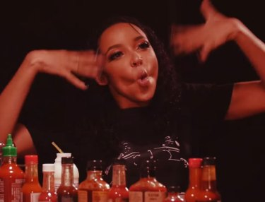 Hot Ones: Tinashe Takes The Hot Wings Challenge