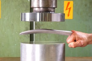 Hydraulic Press Tries to Crush Wolverine's Adamantium Claws