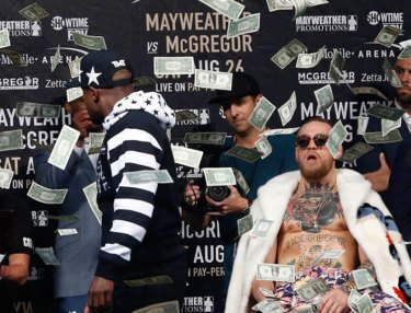 Floyd Mayeather makes it rain on Conor McGregor
