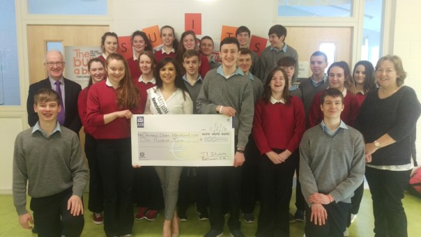 Leitrim Rose Sinead Flynn receiving a donation from SUITS bank