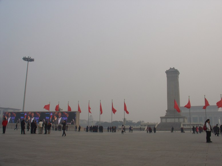 Tiananmen Square with blank red flags, the monument at the right hand and fucking huge LED Screens on the left hand.
