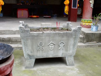 A huge stone ashtray where the praying people can insert their incenses