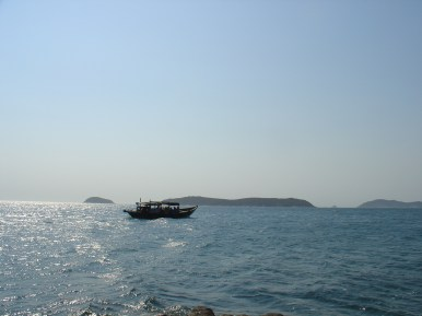 A boat close to the coast.