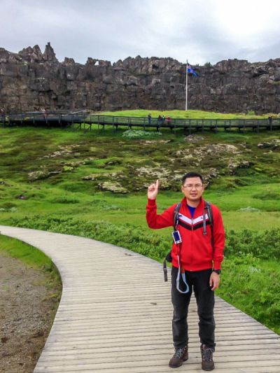 Law Rock with Iceland national flag. Thingvellir National Park, Iceland