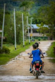 Common sight in Bario. The kids do learn to ride at a young age!