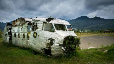 Remains of a plane crash (catered flight with civilians). The wreck was recovered from the mountains and left at the old Bario airport. A monument to remember those whom lost their lives was erected near to this site.