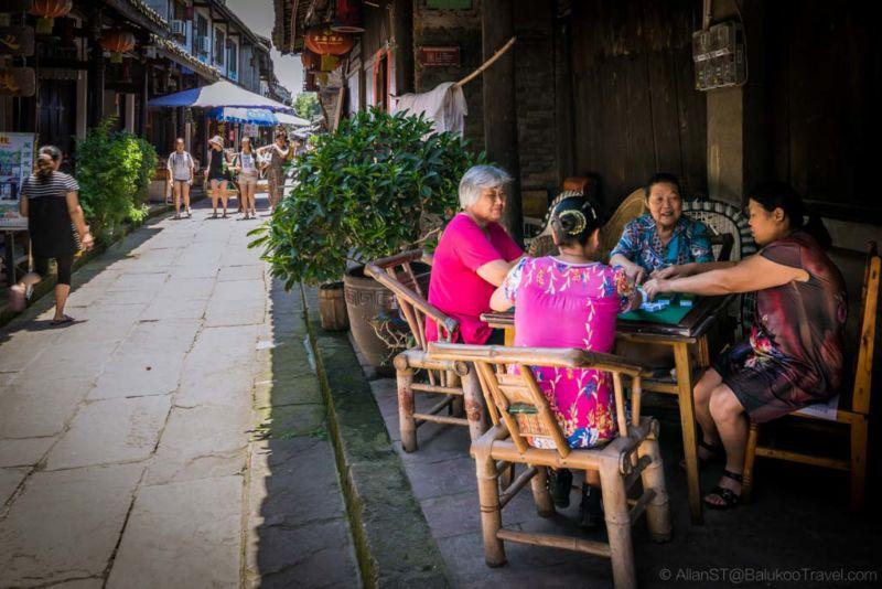 Elders enjoying a game of mahjong. HuangLongXi Ancient town (Chengdu, China)