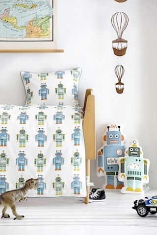 ferm living bedroom with robot bedding and cushions