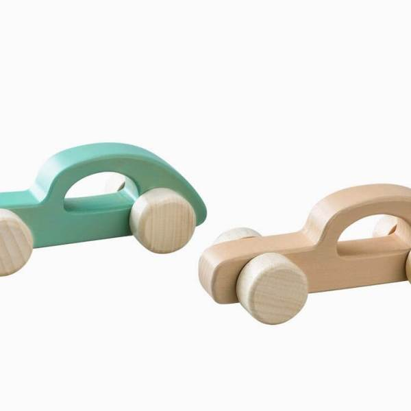 two wooden cars with handle