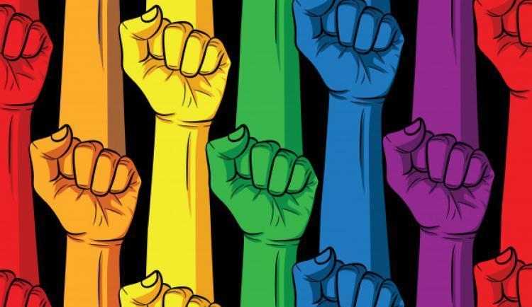 punho-nas-cores-do-arco-iris-em-um-fundo-preto-design-de-cartaz-da-comunidade-lgbt_156811-282