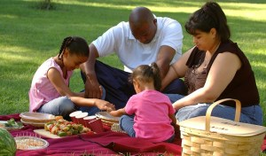 Family praying before a meal - small