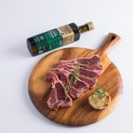 Lamb pieces chop with a olive oil bottle