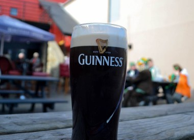 Drinking Guinness, Saint Patricks Day Parade in Downpatrick Northern Ireland
